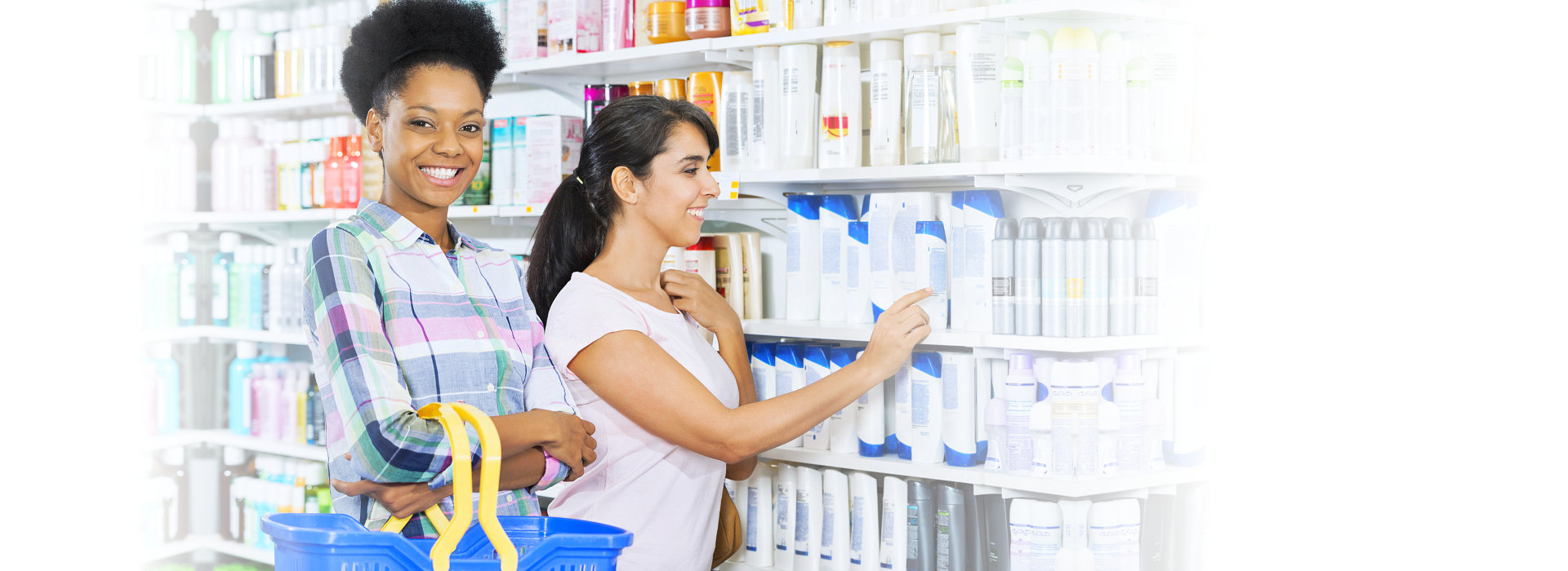 Two young women buying medicines