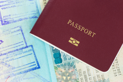 Passport and visa with immigration stamps