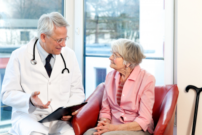 Male doctor in consultation with a senior female patient