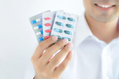 A man holding medicines